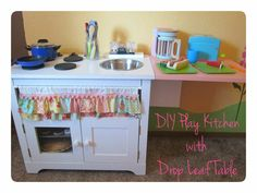Play kitchen with drop leag table tosave space