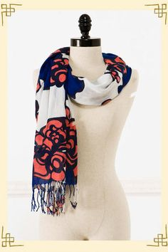 Love the bold coral and blue on this scarf.