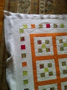 I love the border on this quilt, and the quilting around the 9 patch. makes a simple quilt elegant..