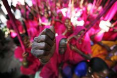 "Members of ""gulabi gang,"" (pink gang), a women's vigilante group, shout slogans at a protest in New Delhi, India, Thursday, Sept. 17, 2009 as they demand a separate Bundelkhand state. The group so named after the pink dress that they wear was formed in Uttar Pradesh State's Banda district. The women brandish sticks and fight for social issues."