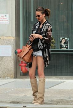 Here is Chrissy Teigen lookingtoo goodin the Givenchy boots of my dreams.