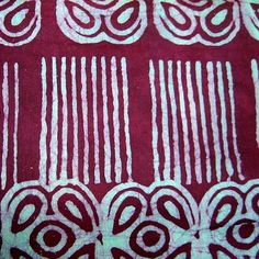 100% cotton. Preshrunk, colorfast. Hand stamped batik created by applying wax with a carved stamp to a solid color base cloth. The wax forms a resist and the cloth is then over dyed. This process may