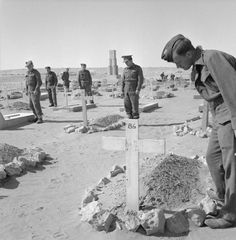 Troops passing through Tobruk visit the graves of their comrades. The graves belong to Australian, Polish, South African, New Zealand and British soldiers.