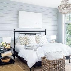 Blue Shiplap Wall with Black Iron Bed