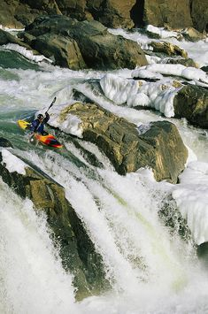 ✮ Kayaker at the top of a waterfall