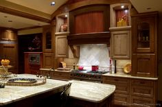 Google Image Result for http://www.kitchen-design-ideas.org/images/kitchen-cabinets-traditional-two-tone-001a-s4948888-light-medium-dark-wood-island-luxury.jpg