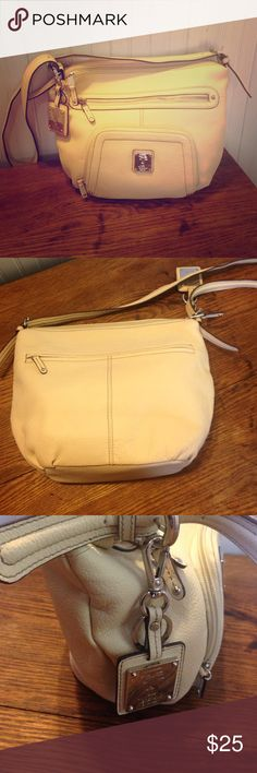 "Tignanello cream 100% leather purse. Tignanello cream 100% leather purse. Beautiful like new excellent condition. Cream/ off white color. This has a long shoulder strap, could be worn as a crossbody. 14"" across, 11"" high, 4""wide. Two zipper pockets  in the front. Two zipper main compartments, one compartment has two slit pockets and one compartment has a large zipper pocket. This purse is beautiful! Tignanello Bags Shoulder Bags"