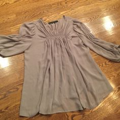 Sheer top Beautiful gray sheer top with gathered stitches on front , back and on sleeves. New with no tags. Zara Tops Blouses