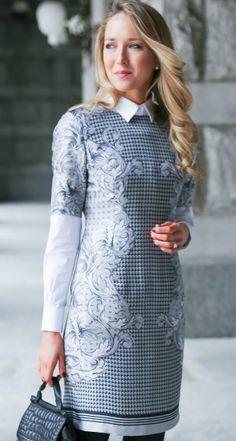 grey printed short sleeve silk sheath dress, layered white collared button down shirt, black tights + black wool maxi coat
