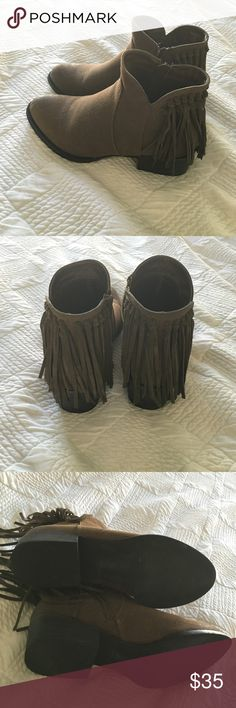 Cathy Jean fringe booties Super cute broken fringe booties. Has a zipper on the side to put them on and the heel height is a little shorter than 2 inches. The fringe is all in tact. Worn once Cathy Jean Shoes Ankle Boots & Booties