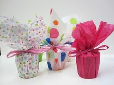 DIY Votive Favors with brightly colored tissue paper wrappings or colors of the wedding??