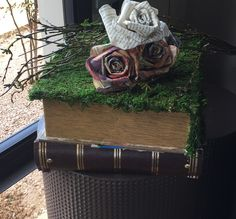 This became my favorite tabletop decoration.  It is newspaper and magazine flowers atop a huge book (covered in newspaper) and then covered in moss. I wanted a lot of my decorations to appear that they had been left out in the forest and I think this nailed it!