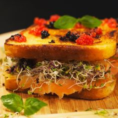 Now this is what we call an extravagant sandwich! Crunchy toast with smoked salmon red and black caviar and radish sprouts. A few drops of lime juice will balance the taste and take your sandwich experience to a whole new level!