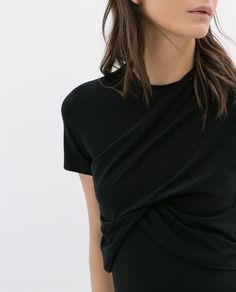 black tee with a twist. and nude lips.