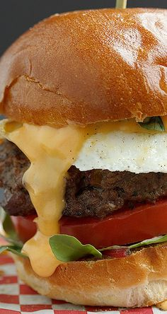 Bacon Jam Filled Beef Burger Topped with a Fried Egg and Cheddar Beer Sauce