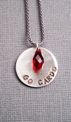Am I a St. Louis Cardinals fan.....heck yea. Go Cards. It is baseball season and I wear this pendant to cheer on our team. I can make one for you, be it professional, college or high school.....show your team spirit.  Pendant with your team name  and a Swarovski briolette in your team's color made to order  $56.00