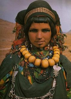 "H'dda at the annual ""brides fair"" where she may catch the eye of a suitor. If her parents approve, a prolonged courtship begins. Girls are technically not allowed to marry until they are 16, but the Berbers don't always observe this law. Imilchil village, Morocco, 1995"