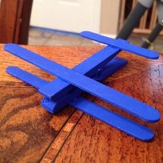 My daughter and I made this little airplane together.  She helped paint all of the pieces, and I glued them together.  She loves it.  Got the idea from parents.com.  Just a clothespin, 2 Popsicle sticks, and one mini craft stick.  Easy peasy.
