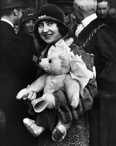 Elizabeth, Duchess of York , later the Queen Mother, on a visit to East Ham in London. She is carrying a teddy bear for her daughter Princess Elizabeth. Get premium, high resolution news photos at Getty Images Princess Margaret, Princess Elizabeth, Queen Mother, Queen Mary, Lady Elizabeth, Antique Teddy Bears, Royal Uk, Bear Photos, Duchess Of York