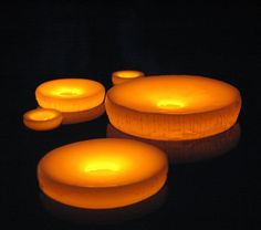 I lovveeee these! Flameless floating candles....pretty pretty pretty!