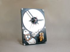 Desk clock made from a recycled computer hard by ReComputing.