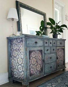 Sharon of Naw Too Shabby transformed an old, orange oak unit with Chalk Paint®. She first applied 2 layers of Chalk Paint® in Duck Egg Blue and then heavily distressed it. She finished it with Clear, Brown and Black Chalk Paint® Wax. Such an incredible piece!