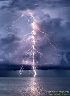 """One of my best positive lightning strikes ever taken. A so-called """"bolt from the blue"""" stroke outside the rapidly developing supercell in the Trieste gulf, Italy on July 9th, 2014. That was just an amazing intro into great night chase! Weather-Photos.NET"""
