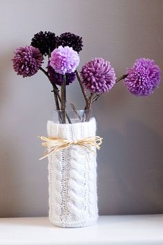 Vase sweater and pom pom flowers on real sticks.