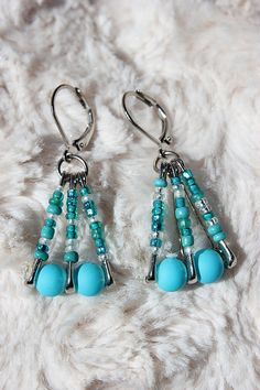 These elegant earrings are a unique piece of fashionable jewelry. These earrings are made out of glass seed beads and 7/8 steel nickel plated safety
