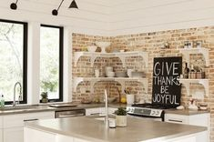 kitchens - exposed brick wall white shelves white kitchen cabinets gray corian counter tops Urban Grace Interiors Gorgeous kitchen design with Brick Wall Kitchen, Kitchen Corner, Nice Kitchen, Awesome Kitchen, Square Kitchen, Kitchen Wood, Beautiful Kitchen, Kitchen Furniture, Kitchen Ideas
