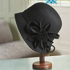 Asymmetric Felted Cloche A smart wool-felt hat, trimmed with a felt flower and band to one side. Recalling the classic silhouette made popular by Parisienne milliner Caroline Reboux Felt Hat, Wool Felt, Caroline Reboux, Love Hat, Felt Flowers, Suzy, Art Deco Fashion, 21st Century, Derby