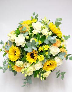 Uplifting yellow sunflowers and refreshing greens. #yellow #flowers #bouquet #sunflower #eucalyptus #london #florist