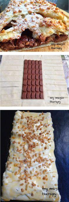 Tarta de chocolate. Fácil fácil: estirar una lámina de hojaldre colocar una tableta de chocolate Nestlé y cerrar. Pintar con huevo y espolvorear con allmendra antes de hornear