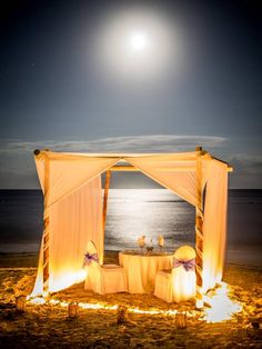 Romantic dinner set up on the beach.