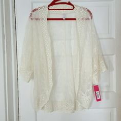 Gorgeous Ivory Lace Kimono Wrap Brand new with tags. Size Small/Medium by Xhilaration. Gorgeous cream colored lace with short sleeves. Perfect for a summer day! Xhilaration Tops Blouses