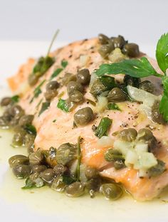Baked Salmon with Lemon Caper Butter is an easy family dinner! Salmon baked to perfection and topped with decadent lemon caper butter. Fish Dishes, Seafood Dishes, Seafood Recipes, Cooking Recipes, Healthy Recipes, Slow Cooking, Cooking Light, Cooking Time, Great Recipes