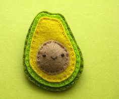 Avocado!  would be a super cute fridge magnet....I can envision a whole slew of felt veggies and fruits donning my fridge!