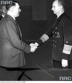 Grand Admiral Karl Doenitz (right) receives from the hands of the leaders of the Third Reich of Adolf Hitler Oak Leaves to the Knight's Cross of the Iron Cross, April 1943
