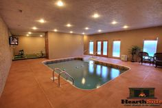HUGE HOME THEATER ROOM, INDOOR HEATED POOL ON BOTTOM LEVEL, Indoor PUTT-PUTT GOLF COURSE, Free wireless internet. Indoor heated pool, 9-hole putt-putt golf course in the basement level, huge home theater room with wet-bar and theater seating, fully-equipped stainless steel kitchen, FOUR KINGSIZE beds and so much more. This cabin really does have it all!