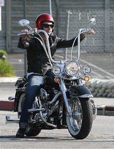 Adam Levine out riding his Harley Softail Deluxe. Nice mini-apes and whale-tail pipes.