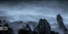 The stormy sea to a rocky beach, at night, turns into a menacing mountain. Cirella / Calabria / Italy. Andrea Bianco Fotografo © 2015