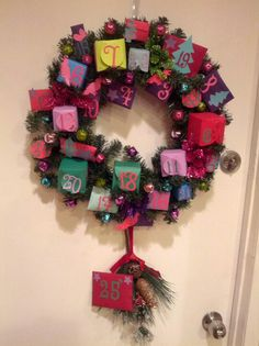 Homemade advent calendar for Christmas.  Just used my cricut  to make boxes and envelopes with numbers on them. Buy a wreath, and make embellishments to create a pretty piece. Just use a hot glue gun to put the boxes in place and enjoy opening one each day.