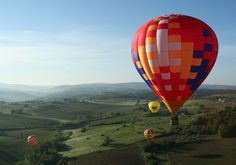 Hot-air ballooning - A wonderful experience.  There are three companies in Tuscany near Siena and La Selva.  We can help you arrange your booking.  Most offer flights at dawn but one does do evening trips.  http://www.balloonintuscany.com/