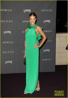 Rosie Huntington-Whitely.  Gucci dress, bag and shoes.  Roseark earrings.   Jennifer Meyer bracelet