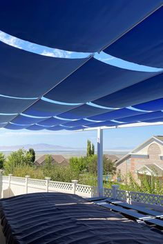 32 retractable fabric awnings on slide