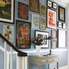 Chose this because we have a dado rail! I like the blue wall colour and then the eclectic mix of pics/paintings. I could see myself doing something like this with pictures on the stair wall. Blue Hallway, Hallway Colours, Modern Hallway, Hallway Art, Hallway Pictures, Hanging Pictures, Display Pictures, Hallway Ideas Entrance Narrow, Entrance Hall