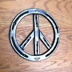 Peace Symbol, horseshoe metal art sign, w/ your date stamped, ready to hang w/ matching screws via Etsy