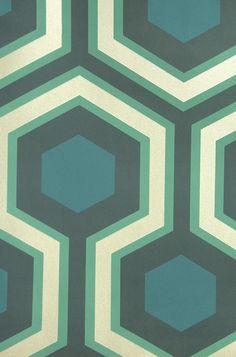 Hicks' Grand Hexagon Wallpaper Large Geometric design wallpaper in aqua and teal with metallic silver embellishment.