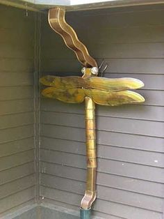 Creative downspouts are excellent decorations for house exteriors