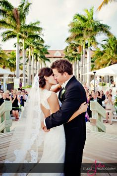 A Key West first kiss at a Casa Marina Resort wedding, photography by Studio Julie- www.studiojulie.com